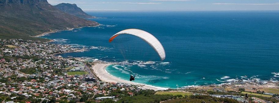 SYDAFRIKA. En semester med utsikt. Flyg tandemskärmflygning från Lion's Head och känn dig fri som en fågel.