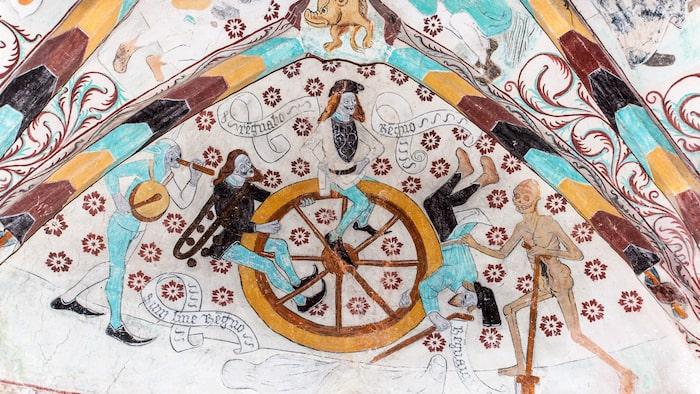 En av Albertus Pictors målningar i Härkeberga kyrkas vapenhus illustrerar Livets hjul, från vaggan till graven, och skapades i slutet av 1400-talet.