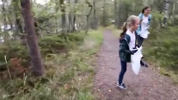 Här plockar Estelle skräp i skogen – se videon