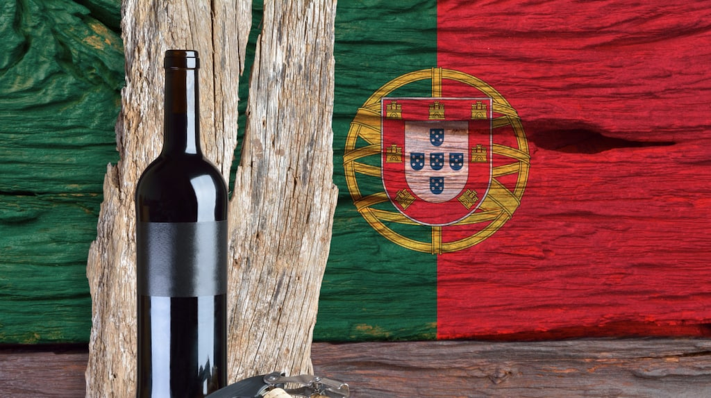 bottle of wine with portugal flag in the background