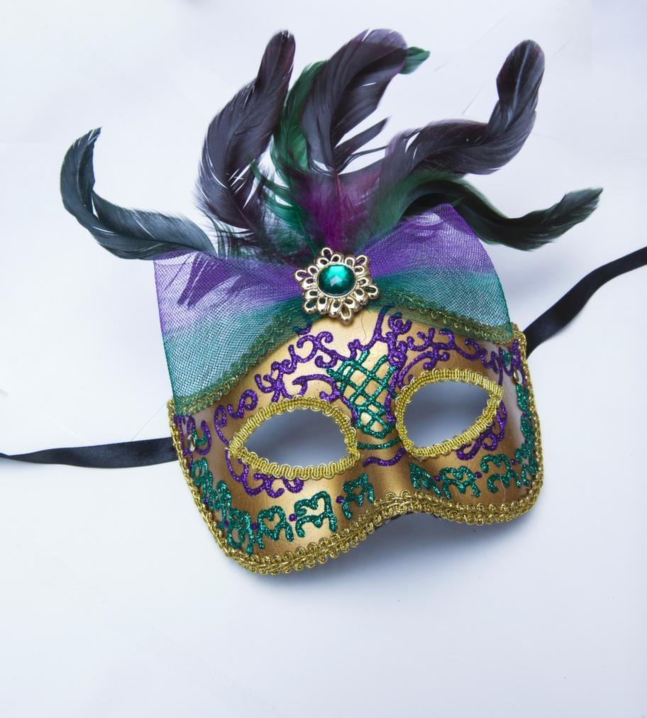 Mask i lila och guld, 280 kronor.