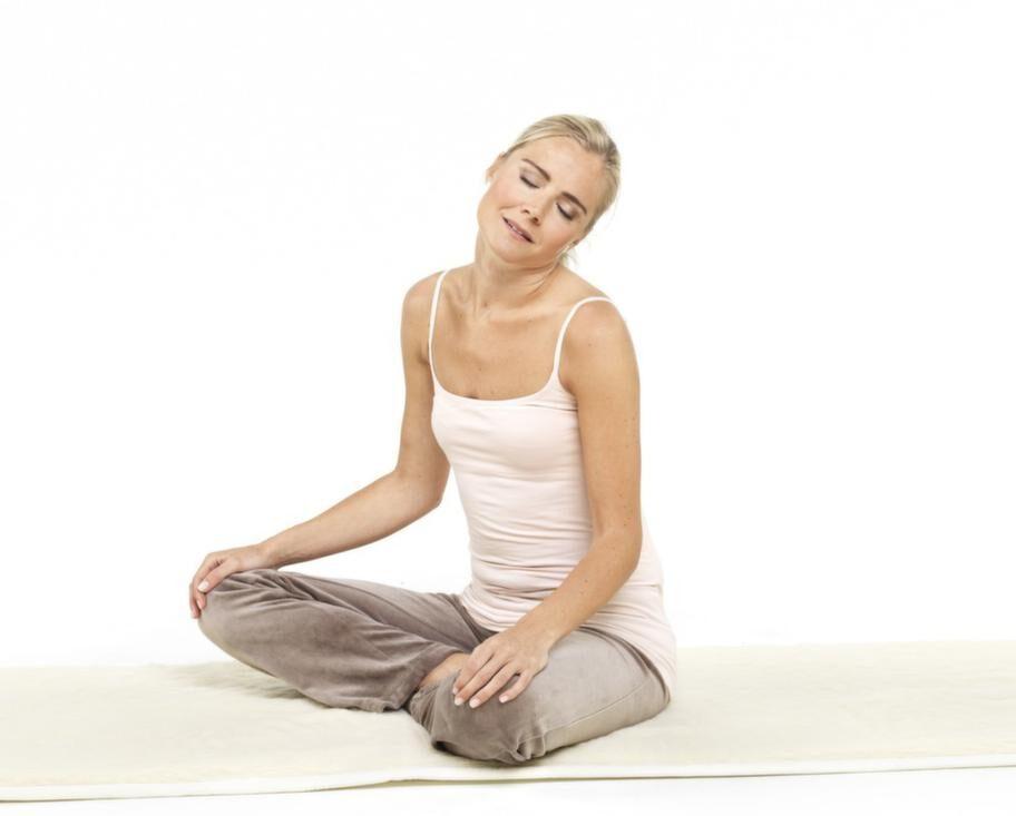 Yogaövning 2 - Nackrullning